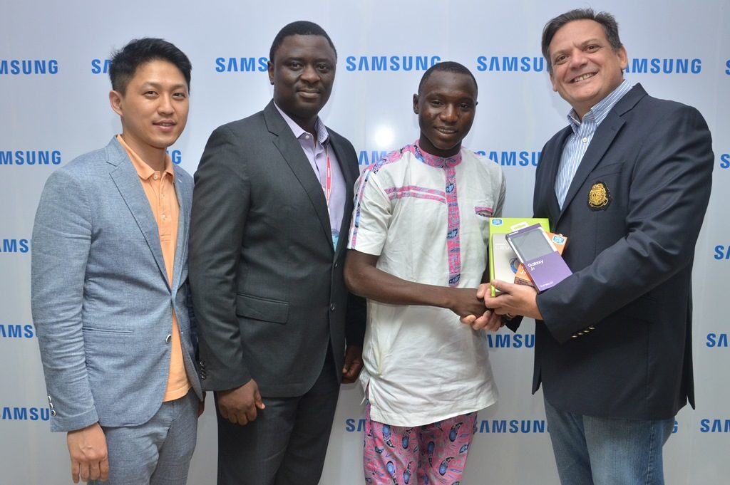 """L-R: Manager, Product Marketing, Chaejin Im; Director, Information Technology & Mobile, Mr. Olumide Ojo, both of Samsung Electronics West Africa; Winner, Samsung """"Inspire Bigger Dreams"""" contest, Ibrahim Ambali; and Director & Business Leader, Information Technology and Mobile, Samsung Electronics West Africa, Mr. Emmanouil Revmatas during the presentation of Samsung mobile devices and accessories to winners of its just concluded campaign at Samsung Offices, VI…5/19/2016"""