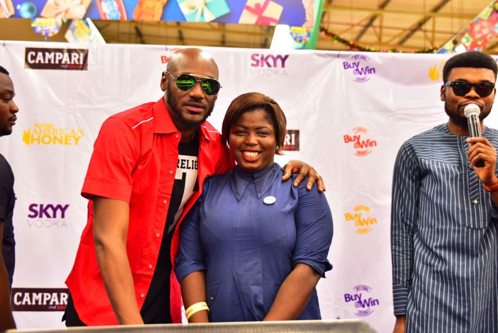 2Baba with a birthday celebrant at Buy N Win Raffle Draw (1)