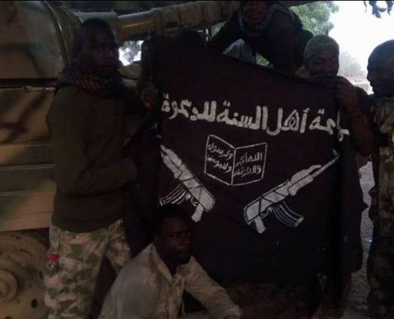 Nigerian army pose with boko haram flag