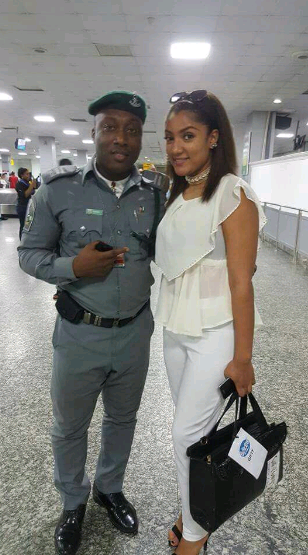 gifty with an airport security guard