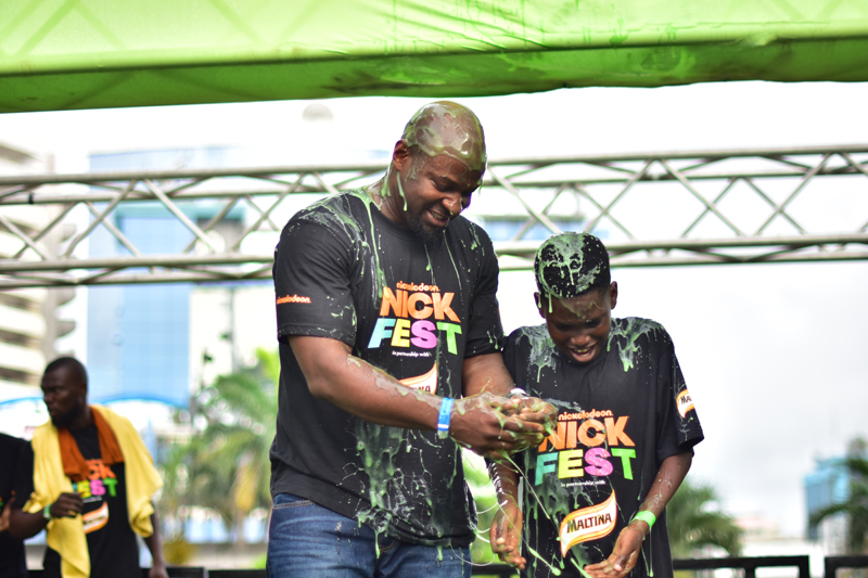 Alex Okosi and his son AJ getting slimed