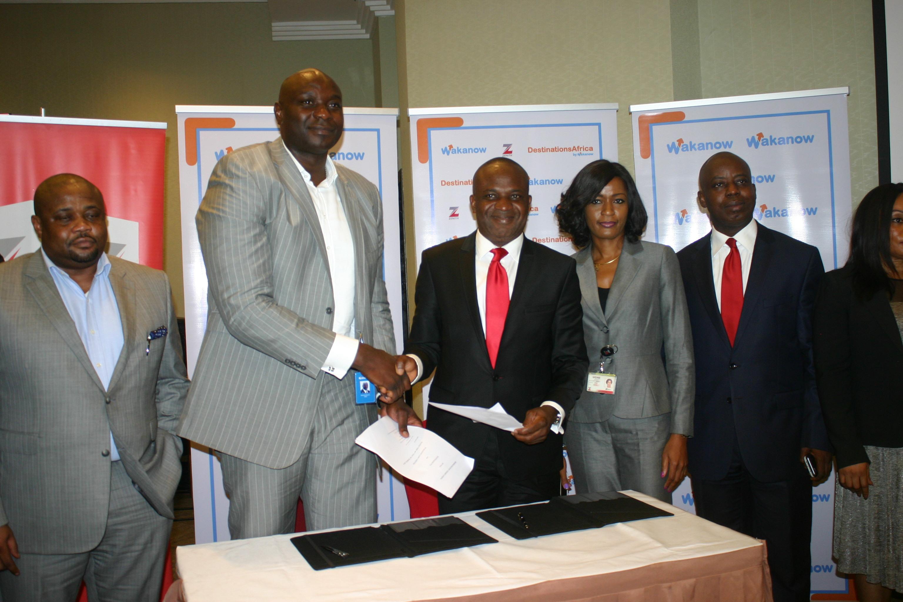L-R Deputy MD of Wakanow, Ralph Tamuno, MD Wakanow, Obinna Ekezie, Executive Director of Zenith Bank, Sola Oladipo with other staffer of Wakanow